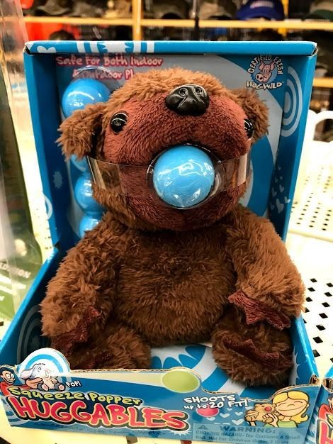 dark design fail of a teddy bear with a ball taped inside its mouth