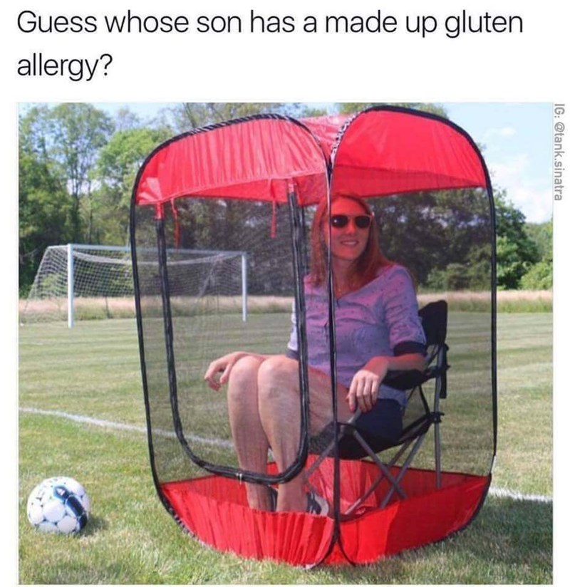 picture of woman sitting inside small personal tent on soccer field to protect herself from gluten