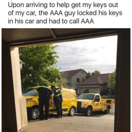 picture of two AAA cars after the first one locked himself outside and had to call the second for help