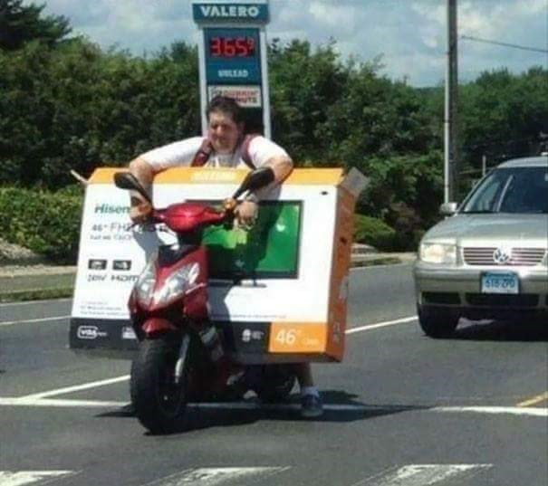 tempting fate by driving a motorcycle with a tv on it