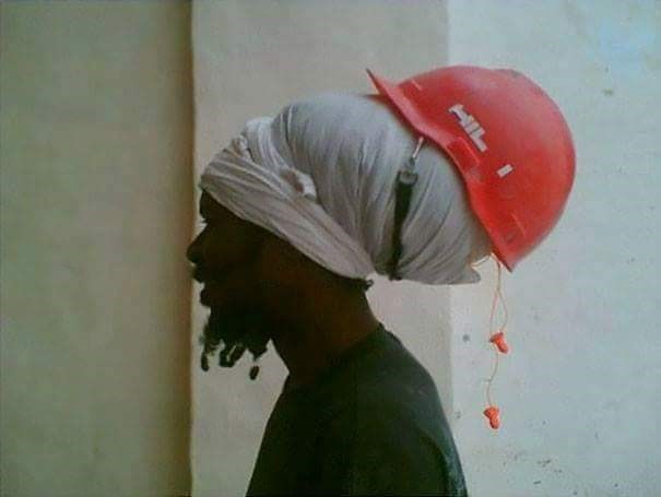 tempting fate by wearing a hard hat not on your head but on your hair