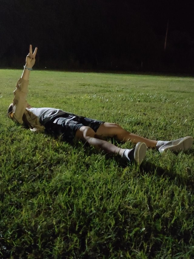 meme perspective of a guy laying on the grass
