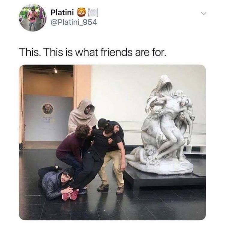 pic of a group of people imitating the pose of a statue