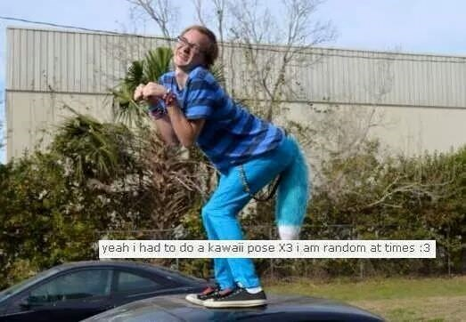 pic of a guy standing on top of a car doing the kawaii pose