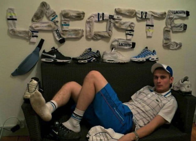 pic of a guy who wrote lactose with his socks on his wall