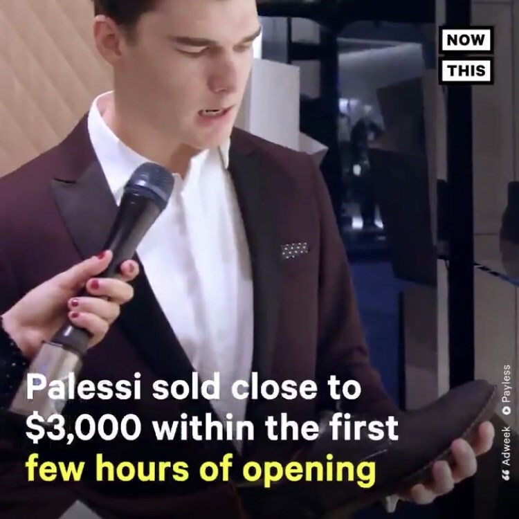 man being interviewed while holding shoe and text on screen describing how much money Payless made from opening the fake store