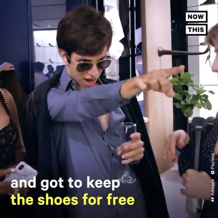 man holding champagne glass and pointing off camera and text on screen explaining Payless let shoppers keep the shoes for free
