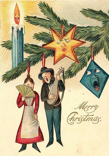 vintage Christmas card with illustration of scary tree ornaments and human figures hanging by their necks
