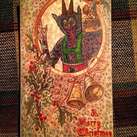 vintage Christmas card with illustration of scary devil creature looking through hole with its long tongue hanging out its mouth