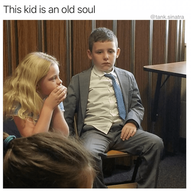 pic of a kid dressed in a suit and tie