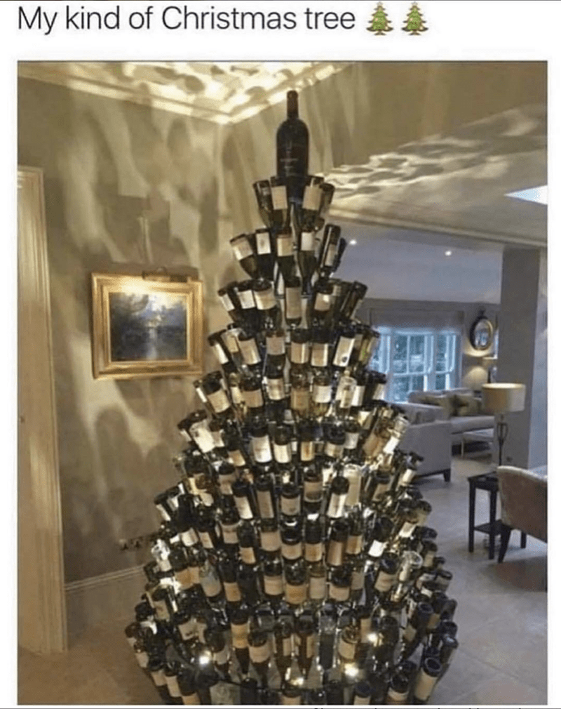 "Caption that reads, ""My kind of Christmas tree"" above a pic of a Christmas tree made out of wine bottles"