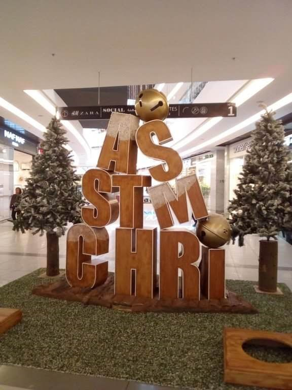 blocks of letters that should say Christmas are not spelled correctly in a mall