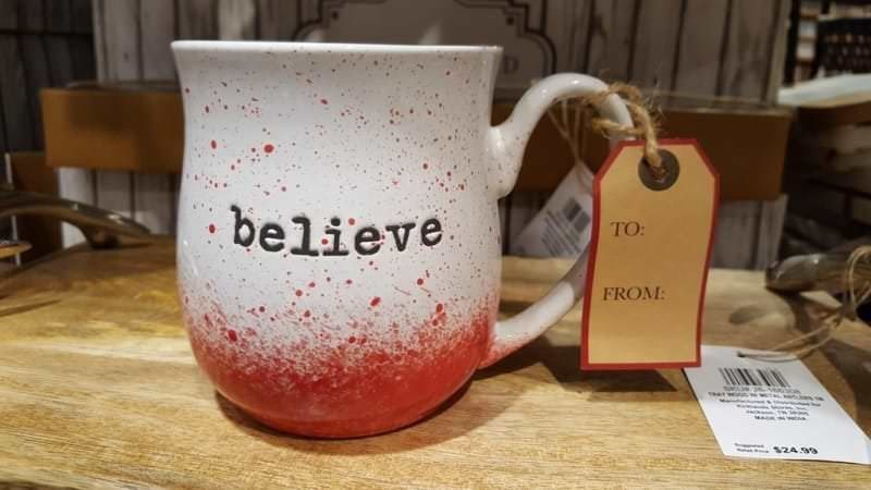 a Christmas mug that looks like blood is pooled at the bottom of it