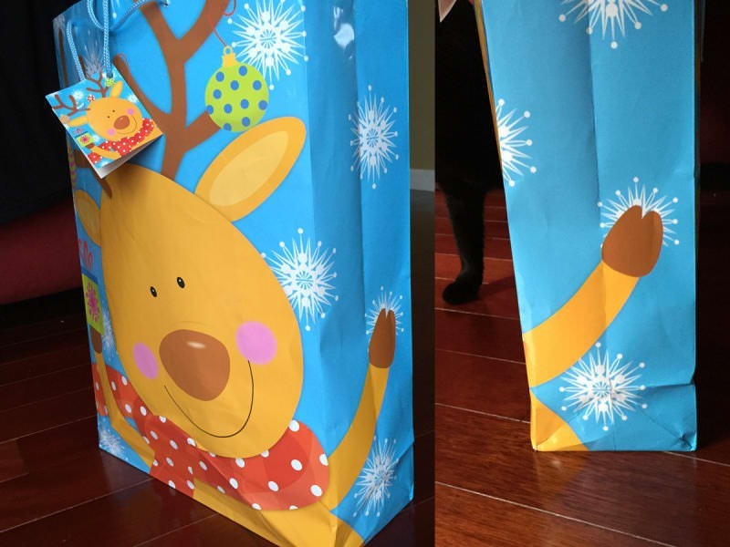 Christmas design fail of a reindeer on a holiday gift bag that its hoof looks different