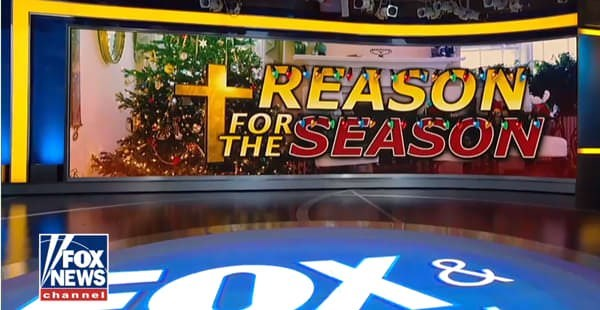 "Christmas design fail on FOX news that a cross is next to the word reason so it looks like it says ""treason"""