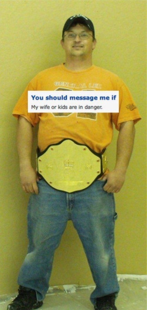 dating site photo of man wearing fake wrestling belt saying to message him if his wife is in danger