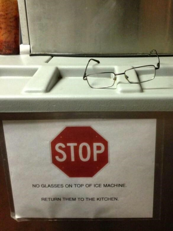 photo of glasses on top of machine above sign prohibiting from leaving glasses there