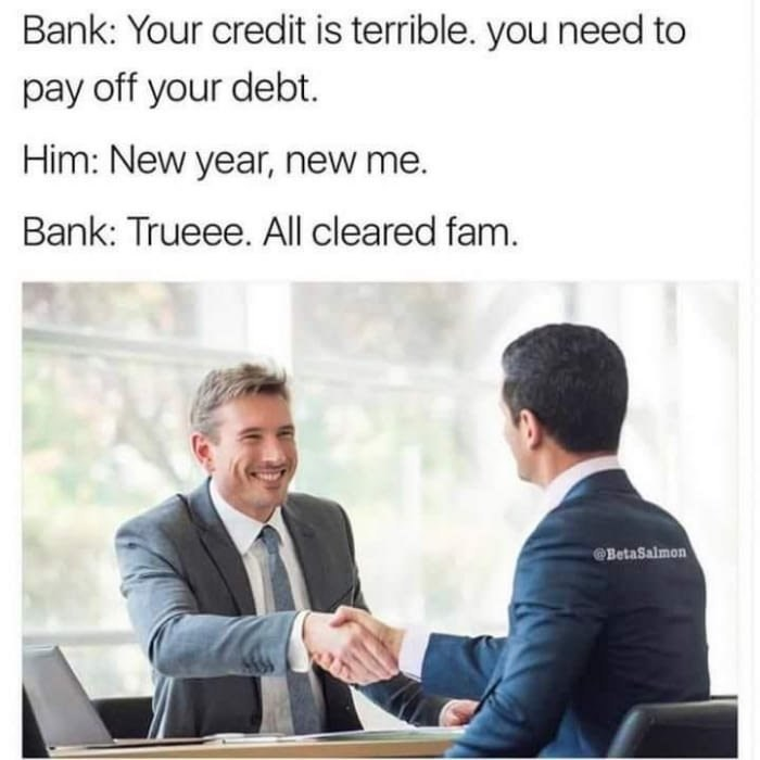 stock photo of suited men shaking hands in meme about the bank clearing your debt for the new year