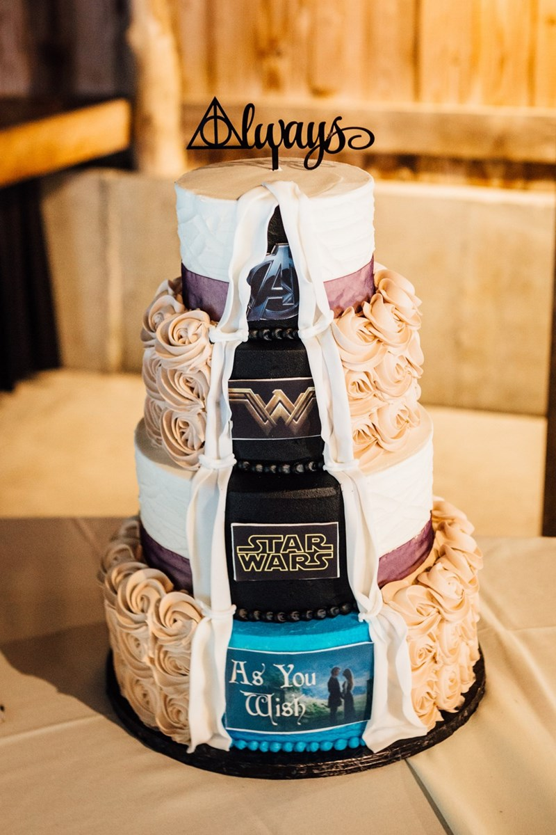 cake that each layer has the logo of various famous movies
