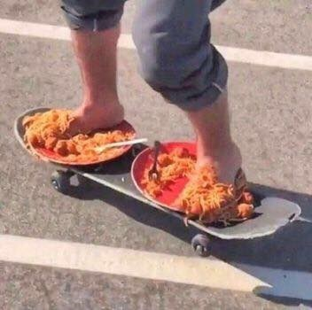 cursed image - spaghetti on a skateboard