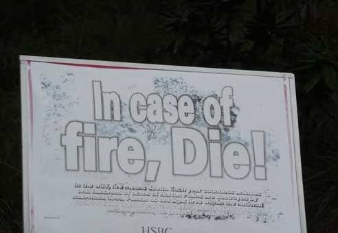 "Sign that reads, ""In case of fire, die!"""