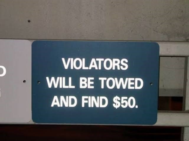Text - VIOLATORS WILL BE TOWED AND FIND $50.