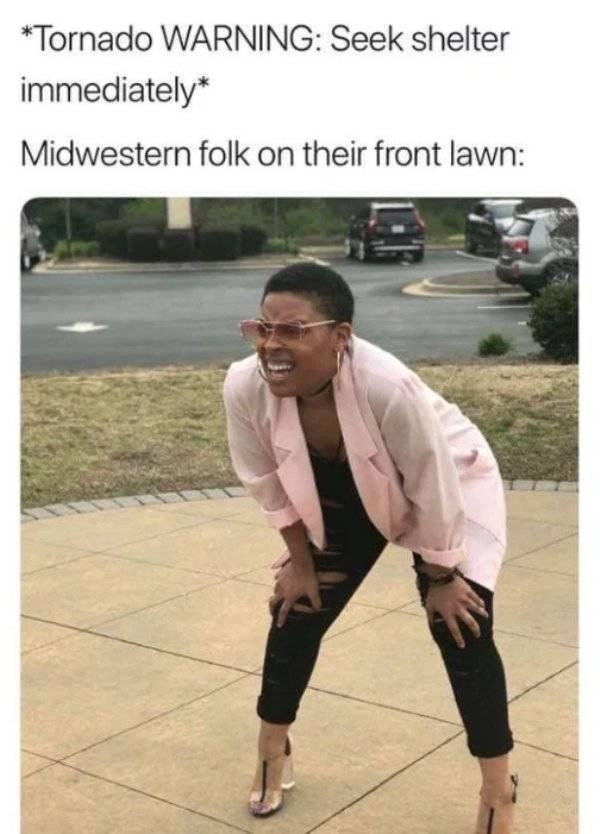 Photo caption - Tornado WARNING: Seek shelter immediately* Midwestern folk on their front lawn: