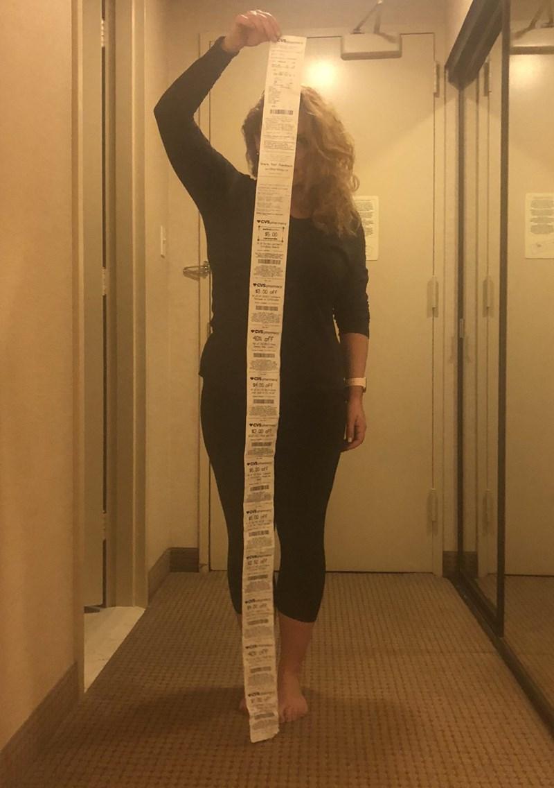 CVS receipt meme that the receipt is taller than the woman holding it