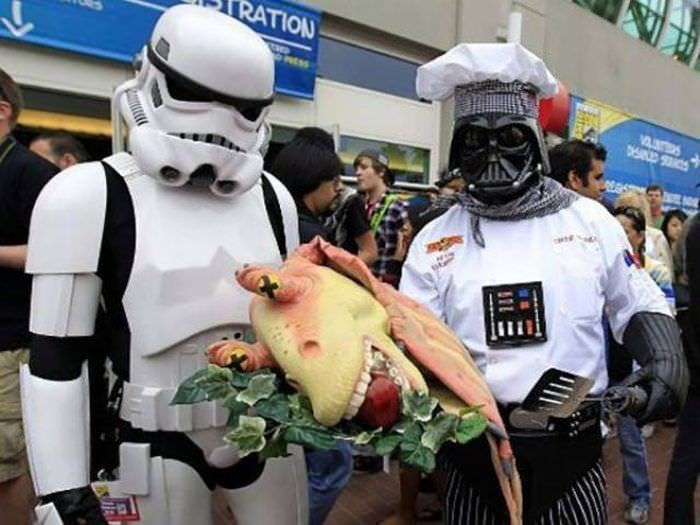strange meme of Stormtrooper and Darth Vader in chef hat serving Jar Jar Bink's head on plate