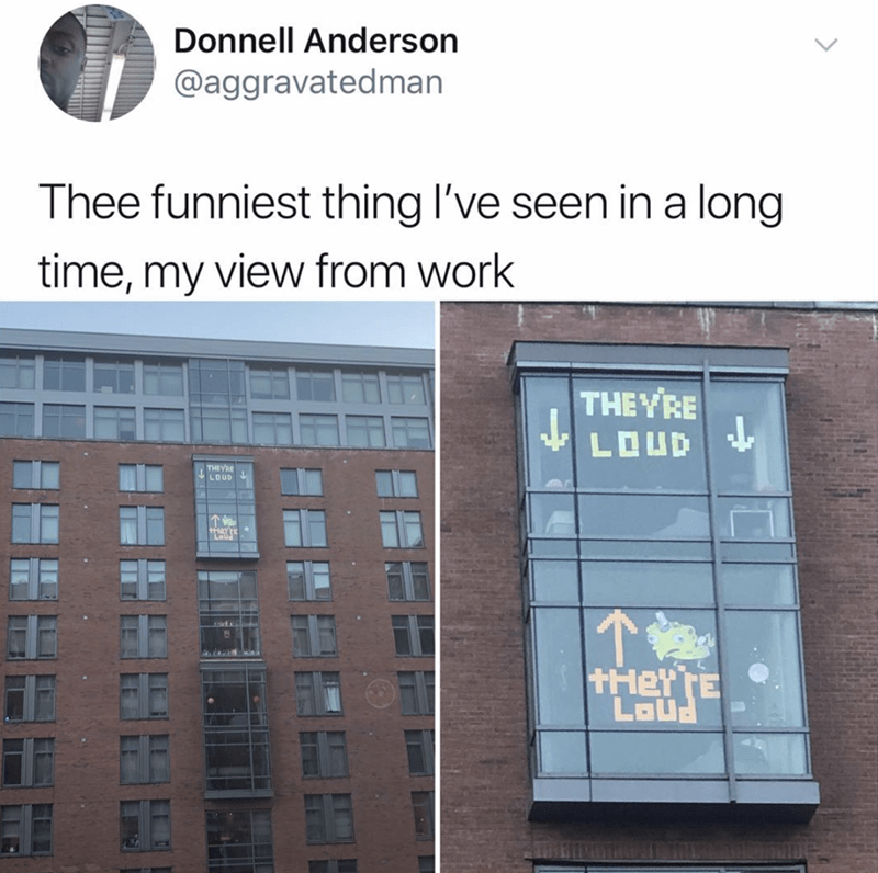 amusing meme of two offices writing messages using sticky notes on windows