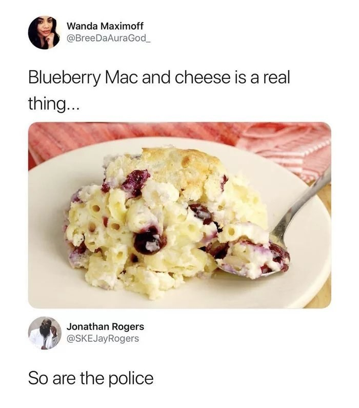 pic of mac and cheese with blueberries being a crime