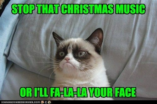 grumpy cat not happy with all the Christmas music being played