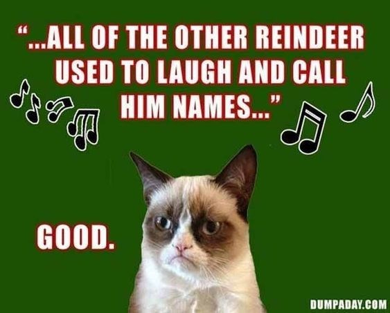 grumpy cat happy about the reindeer getting made fun of