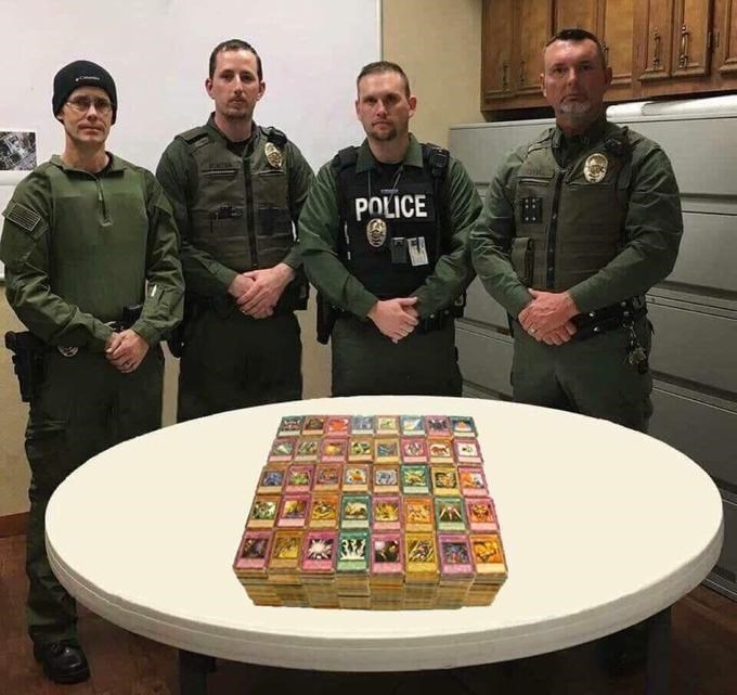 police department roast standing in front of Yu-Gi-Oh cards