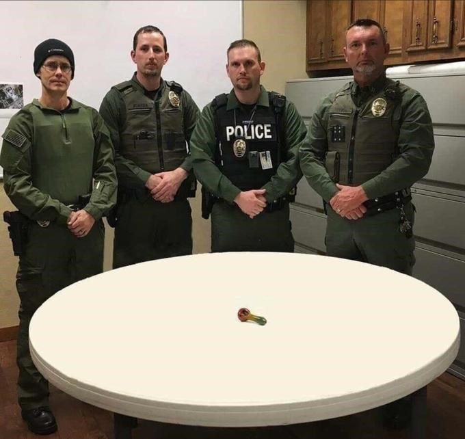 police department roast standing in front of weed glass pipe