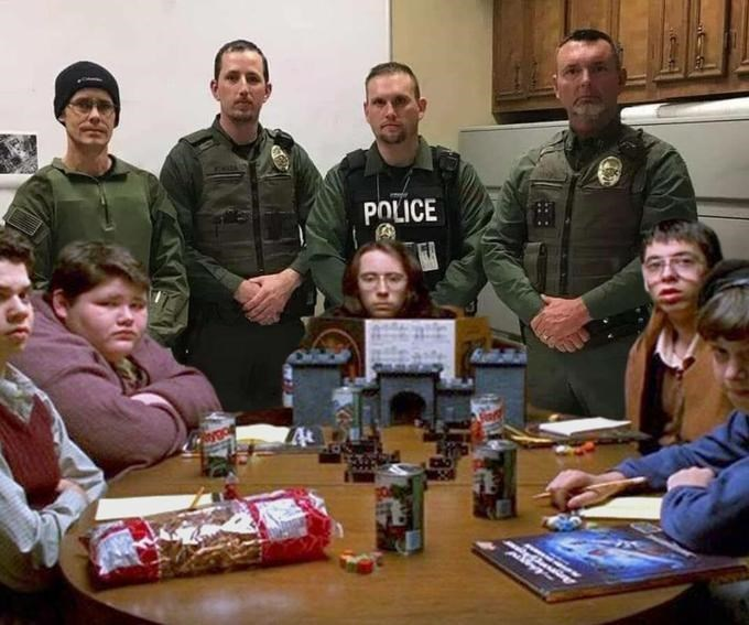 police department roast standing in front of geeks dungeons and dragons
