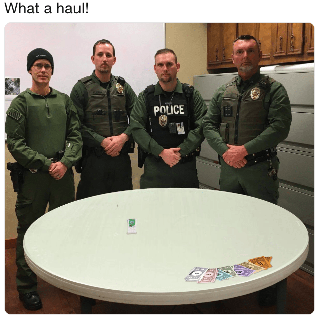 police department roast standing in front of a tic tac bottle and monopoly money