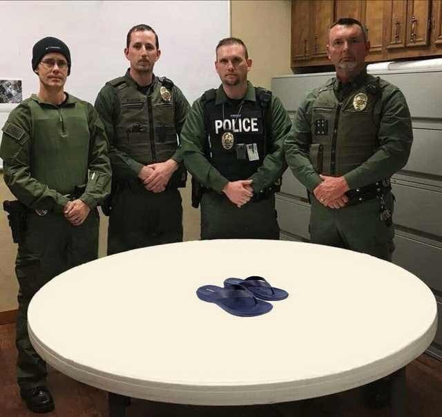 police department roast standing in front of a pair of flip flops on a table