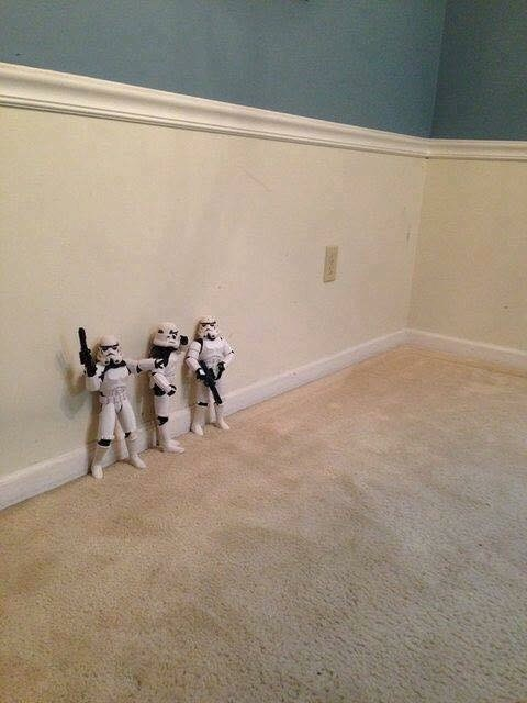 Pic of three toy Stormtroopers standing against the wall
