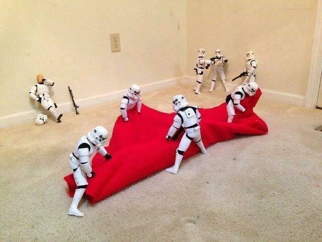 picture of Stormtroopers unrolling red fabric