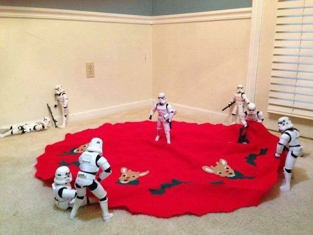 picture of Stormtroopers unrolling red fabric with a few slacking in the background