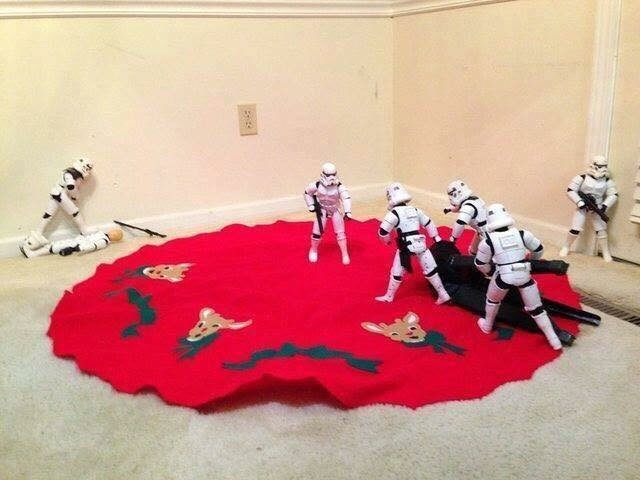 picture of Stormtroopers dragging tree stand to the center of the red fabric