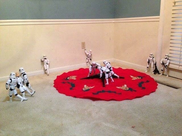 picture of Stormtroopers setting up a tree stand while one of them gets dragged to the side