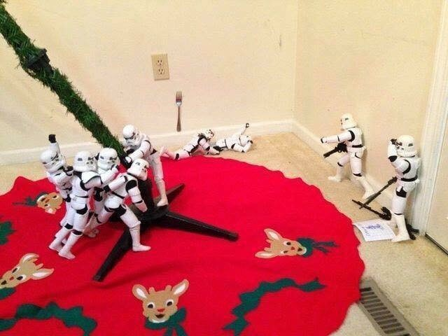 picture of Stormtroopers setting up Christmas tree while one is getting electrocuted in the background