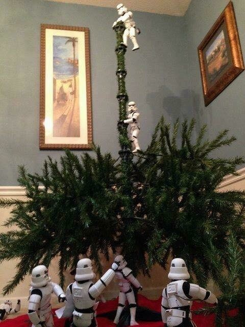 picture of Stormtroopers setting up a Christmas tree