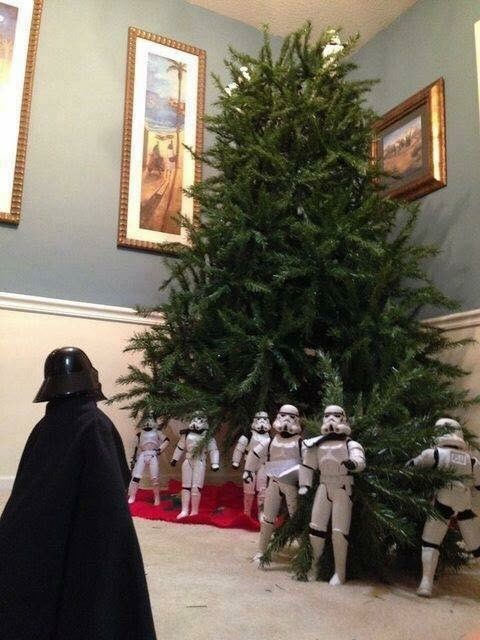 picture of Darth Vader inspecting the Stormtroopers as they set up the Christmas tree