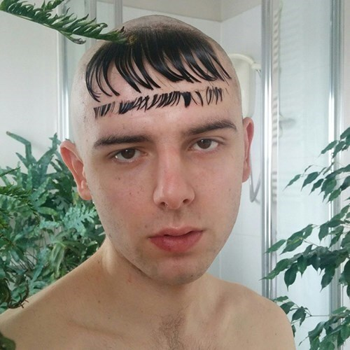 picture of guy with shaved head and long bangs being cut and still stuck to his forehead