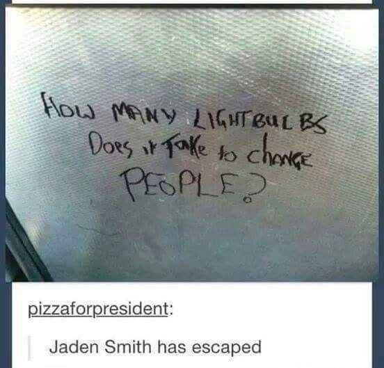 """Graffiti on a window that reads, """"How many light bulbs does it take to change people?"""" above a Tumblr caption that reads, """"Jaden Smith has escaped"""""""