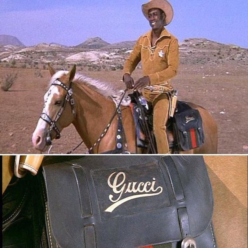 pic of scene from Blazing Saddles of horse with a Gucci satchel tied to its back
