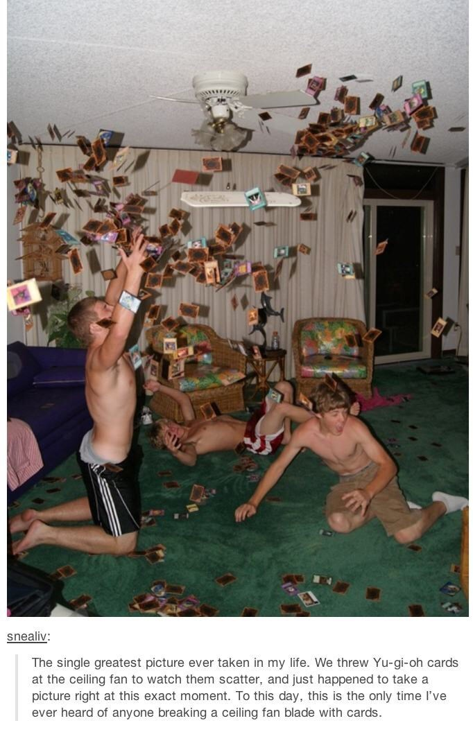 pic of three shirtless guys throwing Yu Gi Oh cards in the air and breaking the ceiling fan